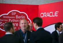 logo of Oracle Corp. sits on the software company's stand at the Connecticum job fair for students, graduates and young professionals at Tempelhof airport in Berlin