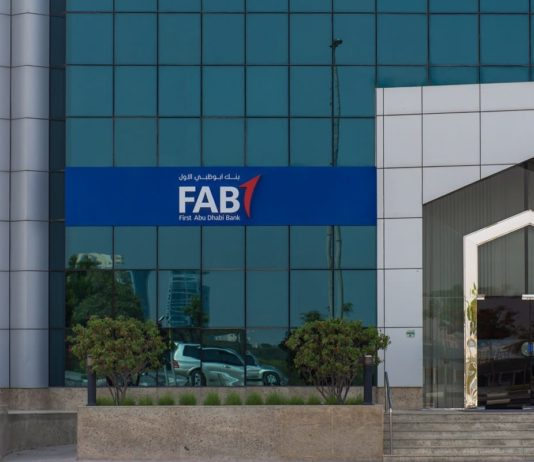 First Abu Dhabi (FAB) Bank blue close up storefront sign and entrance.