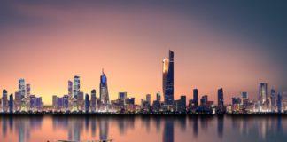 kuwait skyline; kuwait budget deficit lowered