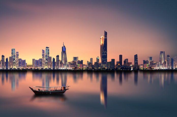 kuwait skyline; kuwait budget deficit lowered; kuwait CMA
