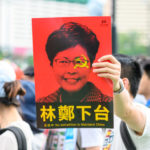 hong kong protester holding sign business news