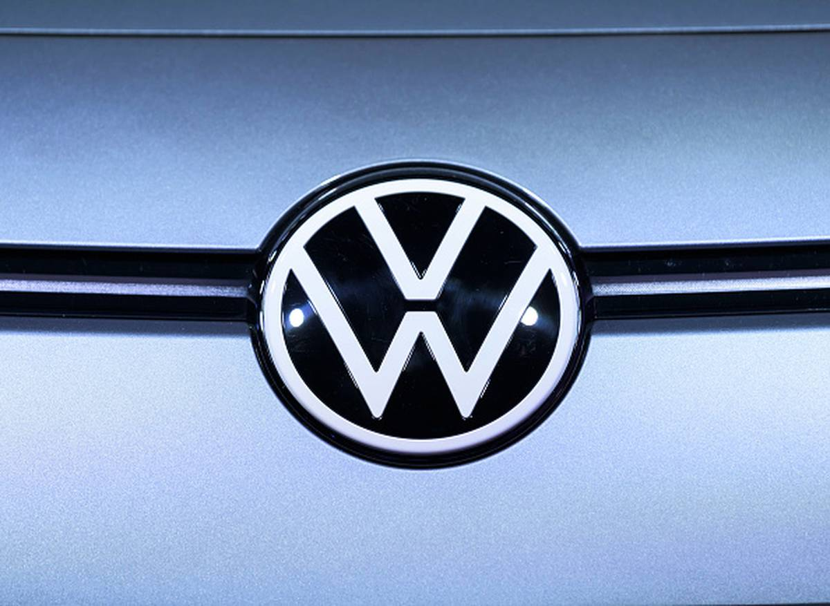 vw unveils new logo  affordable electric cars in show of new era